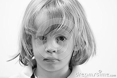 Serious young cute caucasian boy