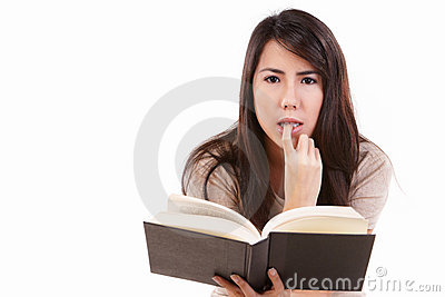 Serious young female with book
