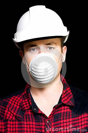 Serious young male artisan wearing protective mask