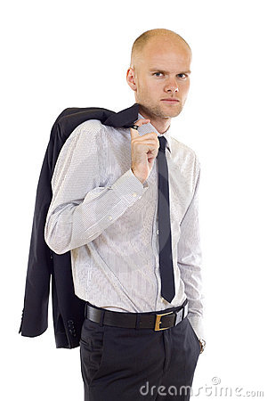 Serious young man  with coat on shoulde
