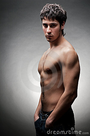 Serious young man with naked torso