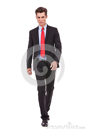 Serious young man walking forward