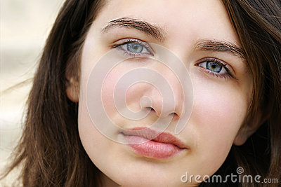 Serious young woman with blue eyes