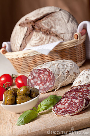 Served kitchen table salami, breadbasket, s