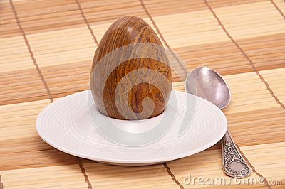 Served stone egg in a rest under egg