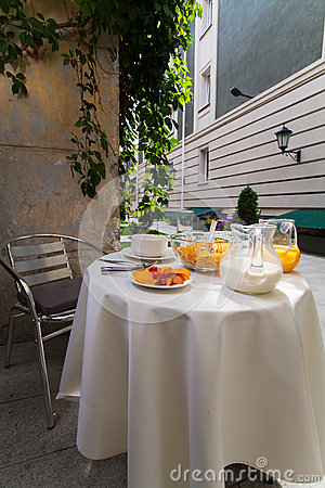 Served vegetarian breakfast table in the courtyard