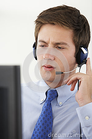 Free Service Agent Talking To Customer In Call Centre Stock Photography - 55896602
