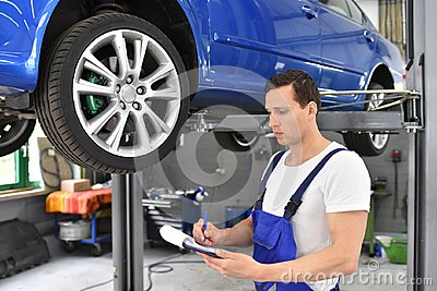 Service and inspection of a car in a workshop - mechanic inspect Stock Photo