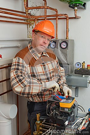 Free Service Man Working On Furnace Royalty Free Stock Image - 30040516