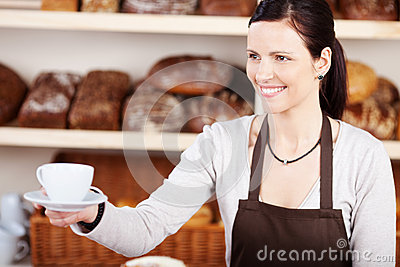 Serving coffee in a bakery