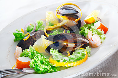 Serving of delicious seafood salad