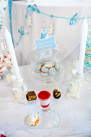 Serving holiday table with white and blue colors