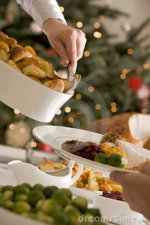 Free Serving Roast Potatoes At Christmas Lunch Stock Image - 5607301