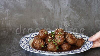 Serving Spicy Asian Beef Meatballs. Spicy Asian Beef Meatballs with room for copy stock video footage