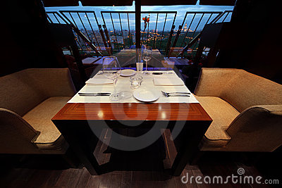 Serving at table and seats in empty restaurant