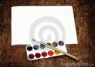 Set of art paints and brushes to paint and paper