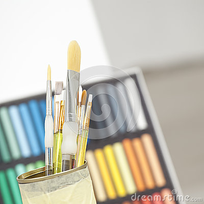 Set of brushes in a can