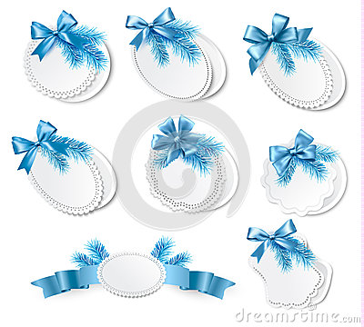 Set of christmas retro labels with  blue gift bows