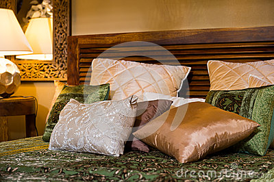 Set of cushions on the bed