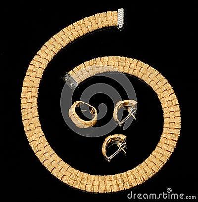 Set of earrings, ring and golden bracelet