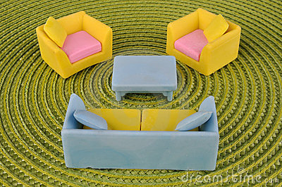 Set of furniture toy on grass intertexture