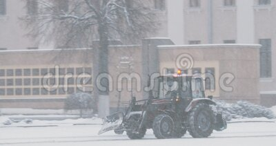 Set. Gomel, Belarus. Tractor Cleaning Snow In Winter Snowy Day.  stock video