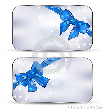 Set labels with blue gift bows isolated