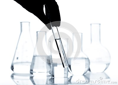 Set of laboratory flasks with a clear liquid