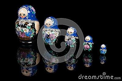 Set of matryoshka dolls on black
