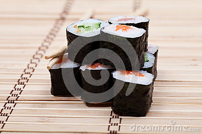 Set sushi with chopsticks on bamboo mat
