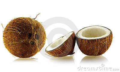 Set of whole and cut coconuts
