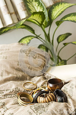 Set of wooden bracelets on a pillow
