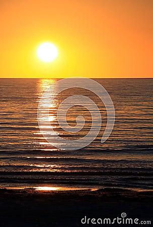 Setting Sun over Ocean. Largs Bay, Australia