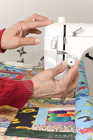 Setting tension on quilting machine.