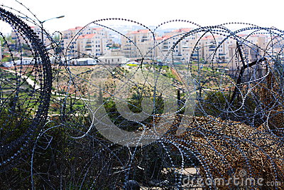 Settlement in West Bank behind barbed wire