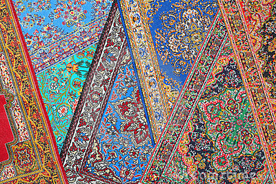 Seven carpets lie in random order on each other