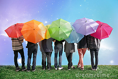 Seven friends with rainbow color umbrellas