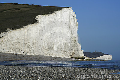 Seven sisters chalk cliffs pebble beach sussex uk