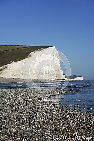 Seven sisters chalk cliffs pebble beach sussex uk