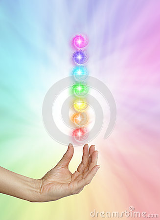 Free Seven Spinning Chakras On Rainbow Colored Background Stock Photos - 71049093