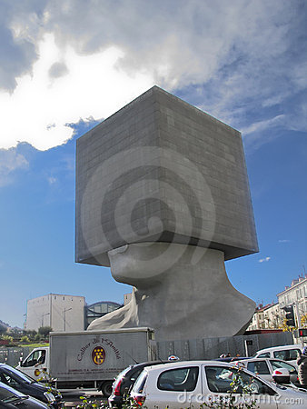 Seven storied building cube shaped as human head Editorial Stock Image