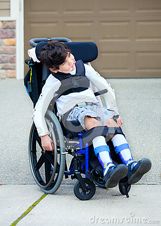 Seven Year Old Biracial Disabled Boy In Wheelchair Stock Photo Image 34712750