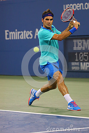 Free Seventeen Times Grand Slam Champion Roger Federer During Third Round Match At US Open 2014 Stock Photo - 49158070