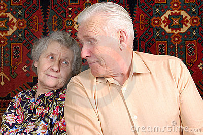 Seventy year old couple smiling at home