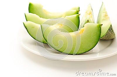 Several cut melon