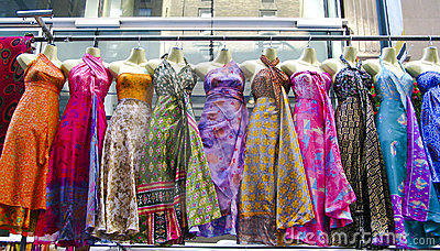 Several dresses hanging up at a market