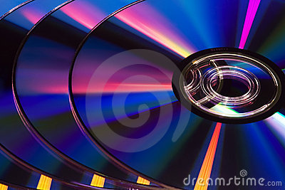 Several DVD discs in blue tint