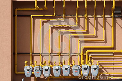 Several Gas Meters on a Wall Editorial Stock Photo
