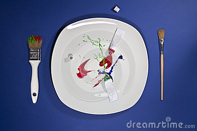 Paint tubes on the plate and paintbrushes on sides