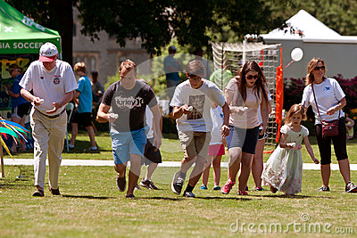 Several People Compete In Egg And Spoon Race At Festival Editorial Stock Photo
